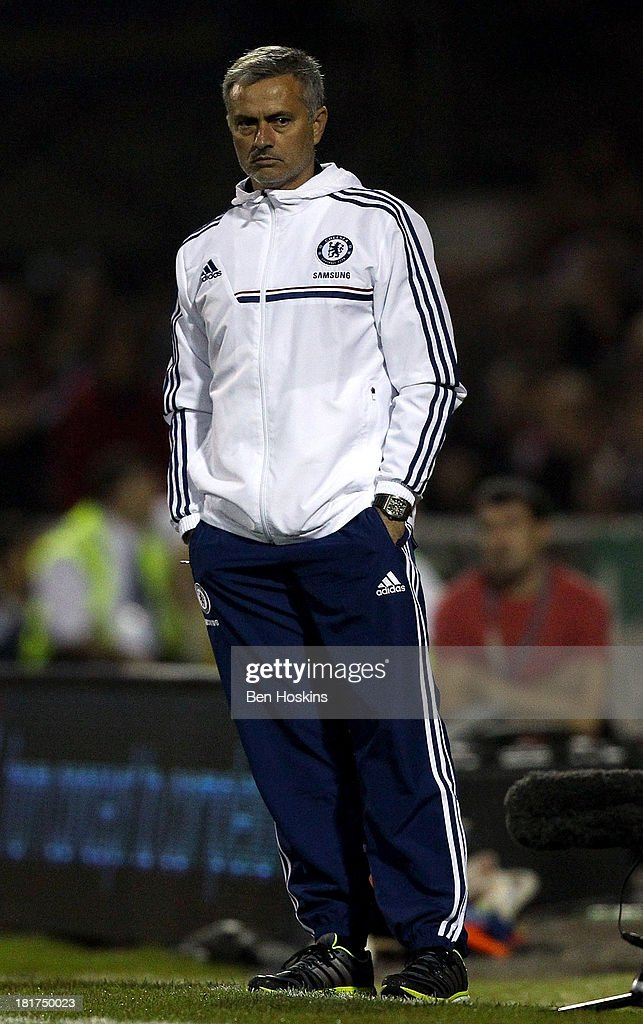 Chelsea manager Jose Mourinho looks on during the Capital One Cup third round match between Swindon Town and Chelsea at County Ground on September 24, 2013 in Swindon, England.