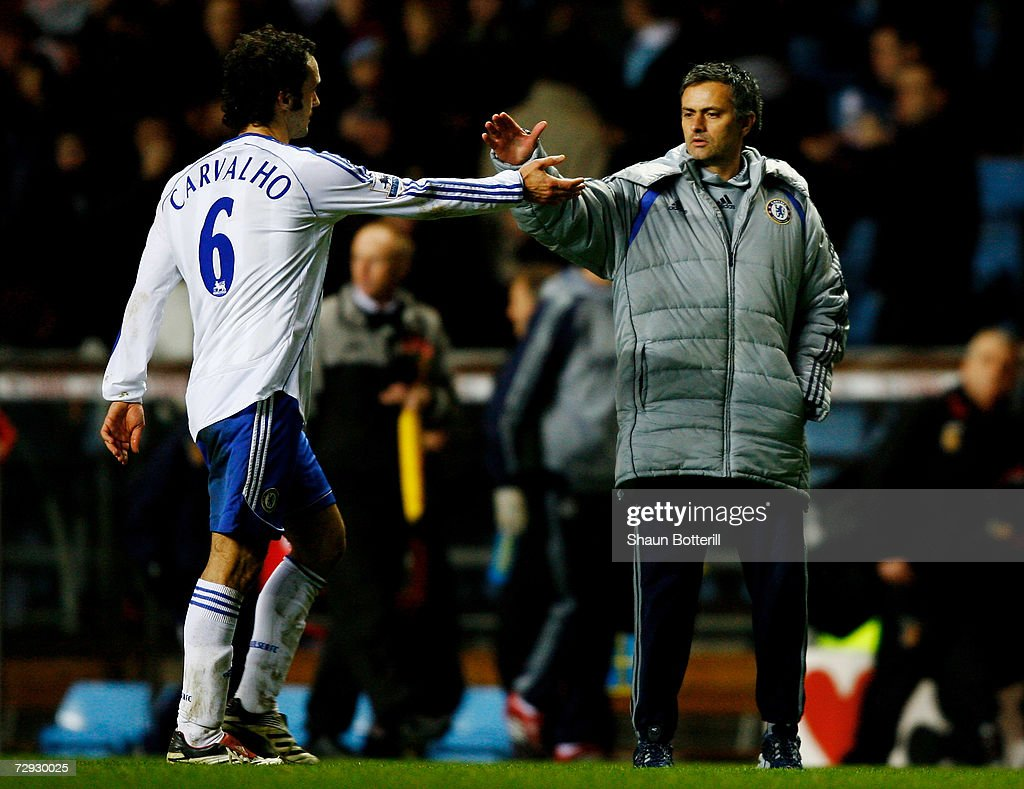 Chelsea Manager Jose Mourinho shakes hands with Ricardo Carvalho after the Barclays Premiership match between Aston Villa and Chelsea at Villa Park...