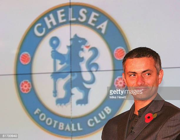 Chelsea manager Jose Mourinho sits in front of the new Chelsea badge during a Chelsea Football Club press conference on November 12 2004 at Stamford...