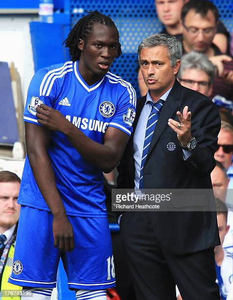 Chelsea manager Jose Mourinho talks to substitute Romelu Lukaku of Chelsea during the Barclays Premier League match between Chelsea and Hull City at...