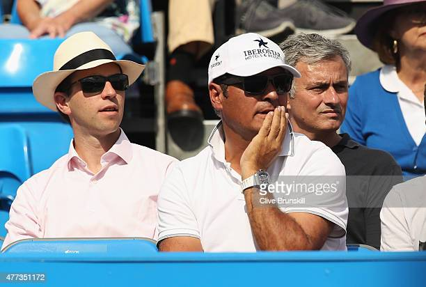 Chelsea manager Jose Mourinho watches the match between Rafael Nadal of Spain and Alexandr Dolgopolov of Ukraine with Toni Nadal coach of Rafael...