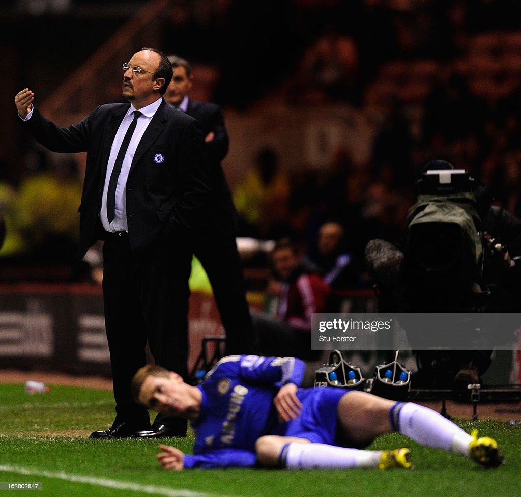 Chelsea manager Rafa Benitez (c) reacts as forward <a gi-track='captionPersonalityLinkClicked' href=/galleries/search?phrase=Fernando+Torres&family=editorial&specificpeople=194755 ng-click='$event.stopPropagation()'>Fernando Torres</a> (r) ends up on the floor after a challenge during the FA Cup Fifth Round match between Middlesbrough and Chelsea at Riverside Stadium on February 27, 2013 in Middlesbrough, England.