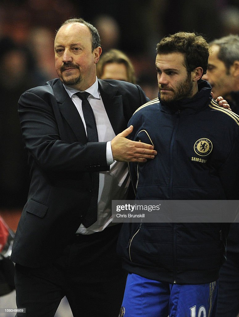 Chelsea Manager Rafael Benitez congratulates Juan Mata at the end of the Barclays Premier League match between Stoke City and Chelsea at the Britannia Stadium on January 12, 2013, in Stoke-on-Trent, England.