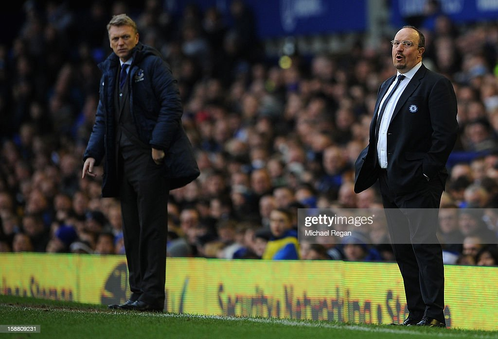 Chelsea Manager Rafael Benitez reacts as Everton Manager David Moyes (L) looks on during the Barclays Premier League match between Everton and Chelsea at Goodison Park on December 30, 2012 in Liverpool, England.