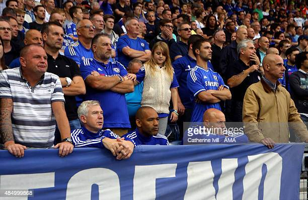 Chelsea masseur Billy McCulloch Jose Morais first team coach and Carlos Lalin first team fitness coach of Chelsea sit in amongst the fans during the...