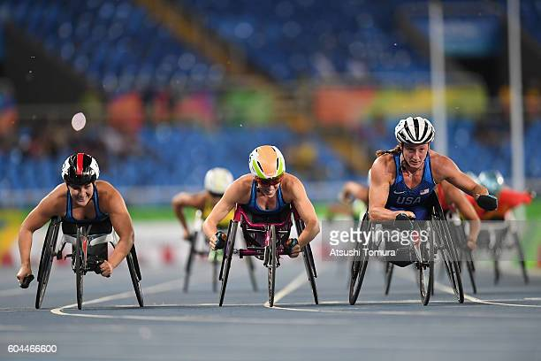 Chelsea McClammer Amanda McGrory and Tatyana McFadden of the United States celebrate winning the silver bronze and gold medals respectively in the...