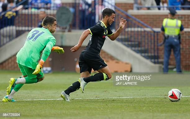 Chelsea midfielder Eden Hazard dribbles past Real Madrid goalkeeper Ruben Yanez to score a goal during an International Champions Cup soccer match in...