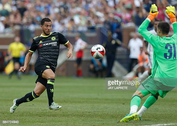 Chelsea midfielder Eden Hazard shoots and scores against Real Madrid goalkeeper Ruben Yanez during an International Champions Cup soccer match in Ann...