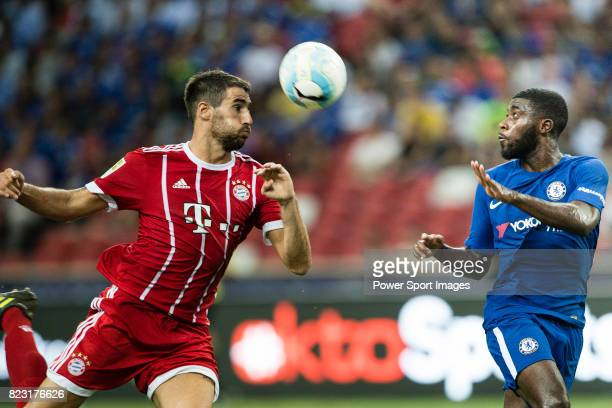 Chelsea Midfielder Jeremie Boga fights for the ball with Bayern Munich Midfielder Javi Martinez during the International Champions Cup match between...