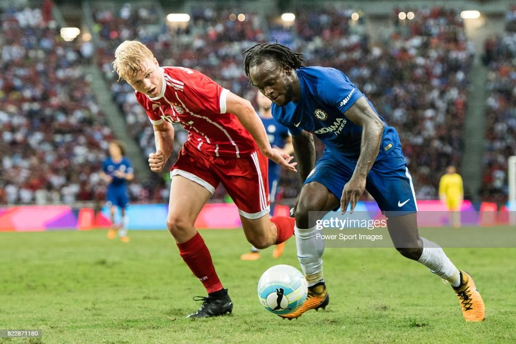 Chelsea Midfielder Victor Moses (R) in action against Bayern Munich Defender Felix Gotze (L) during the International Champions Cup match between Chelsea FC and FC Bayern Munich at National Stadium on July 25, 2017 in Singapore.