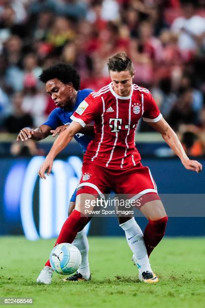Chelsea Midfielder Willian da Silva fights for the ball with Bayern Munich Defender Marco Friedl during the International Champions Cup match between...