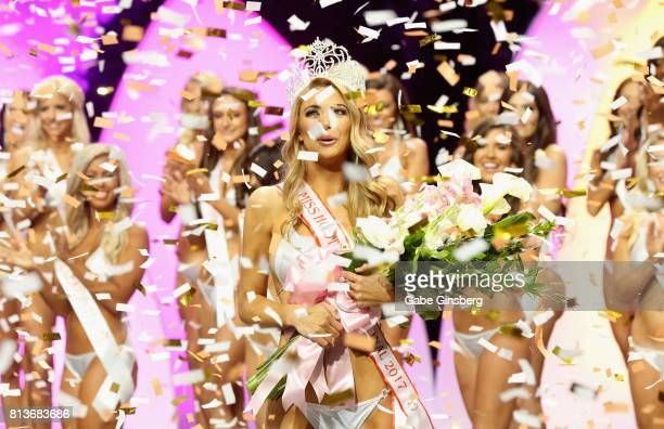 Chelsea Morgensen of Hollywood California looks out at the falling confetti as she walks onstage after being crowned Miss Hooters International 2017...