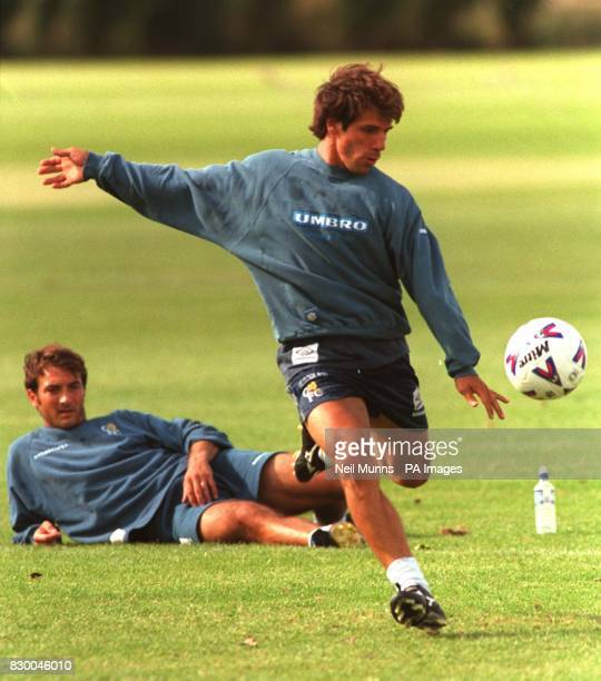 Chelsea new signing Pierlugi Casiraghi watches fellow countryman Gianfranco Zola's shooting technique during a training session today Photo by Neil...