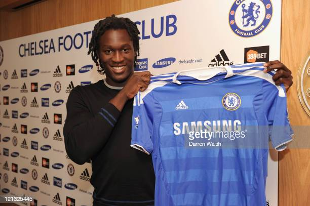 Chelsea new signing Romelu Lukaku poses in the Chelsea shirt at Cobham training ground on August 18 2011 in Cobham England