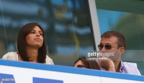 Chelsea owner Roman Abramovich and Daria Zhukova look on prior to the Barclays Premier League match between Chelsea and Bolton Wanderers at Stamford...