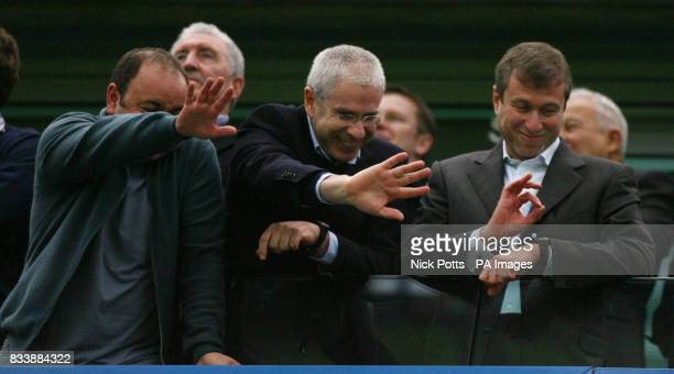 Chelsea owner Roman Abramovich and Director Eugene Tenenbaum wave and give the 'OK' sign to Chelsea Chief Executive Peter Kenyon after 60 home win...