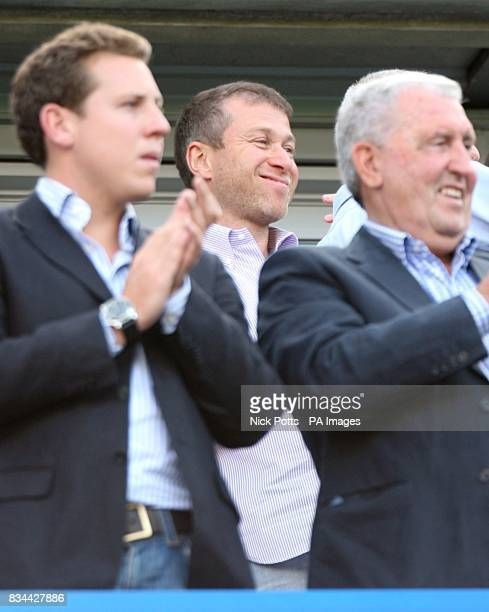 Chelsea owner Roman Abramovich applauds from the stands after the game