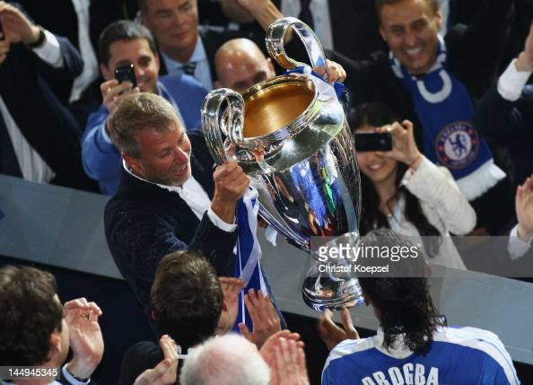 Chelsea owner Roman Abramovich celebrates with the trophy after their victory in the UEFA Champions League Final between FC Bayern Muenchen and...