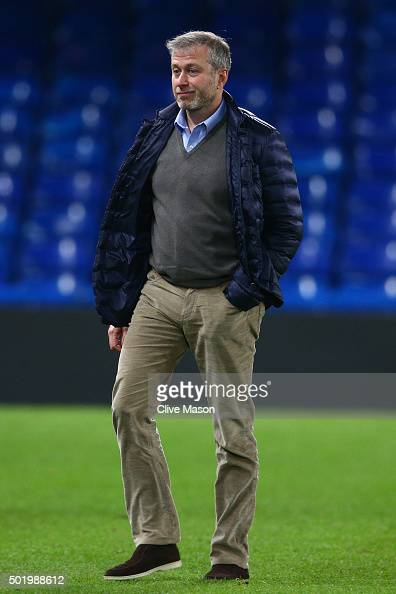 Chelsea owner Roman Abramovich is seen on the pitch to congratulate players on their 31 win in the Barclays Premier League match between Chelsea and...