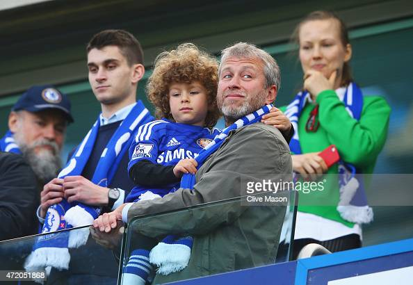 Chelsea owner Roman Abramovich looks on as Chelsea win the Premier League title after the Barclays Premier League match between Chelsea and Crystal...