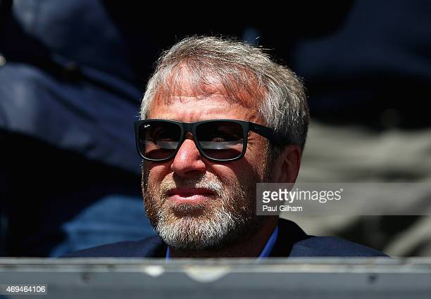 Chelsea owner Roman Abramovich looks on for his 700th game for Chelsea during the Barclays Premier League match between Queens Park Rangers and...