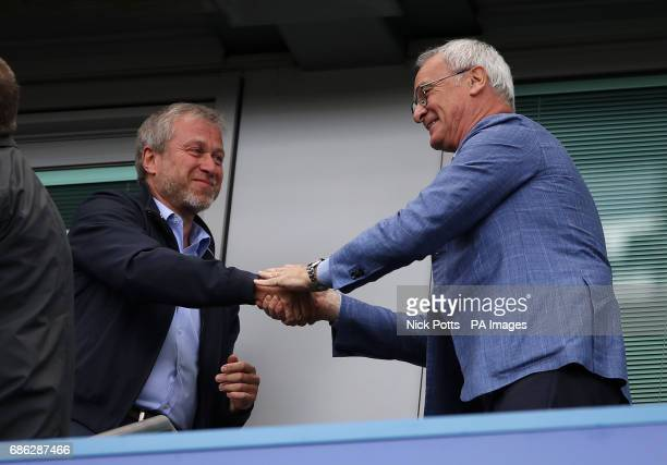 Chelsea owner Roman Abramovich shakes hands with former Chelsea manager Claudio Ranieri in the stands before the Premier League match at Stamford...