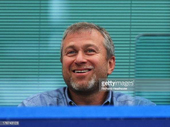 Chelsea owner Roman Abramovich smiles during the Barclays Premier League match between Chelsea and Hull City at Stamford Bridge on August 18 2013 in...