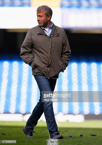 Chelsea owner Roman Abramovich walks across the pitch after the Barclays Premier League match between Chelsea and Crystal Palace at Stamford Bridge...