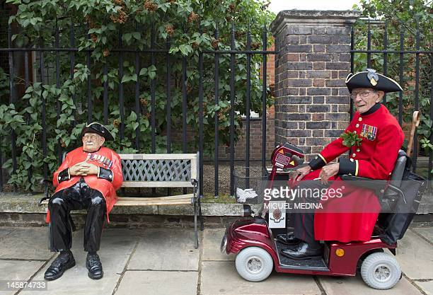 A Chelsea Pensioner a British veteren soldier rides a mobility scooter during the annual Founder's Day Parade at the Royal Chelsea Hospital in London...