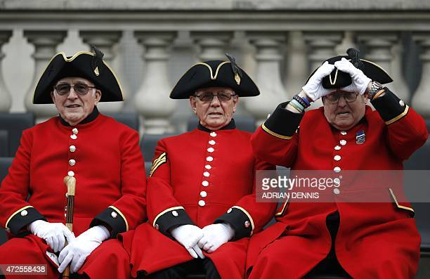 A Chelsea pensioner adjusts his hat as they attend a VE Day service of remembrance at the Cenotaph on Whitehall in London on May 8 to commemorate the...