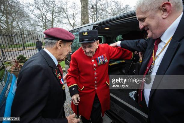 Chelsea pensioner and veteran of World War II Bill Fitzgerald is helped out of a black cab by a taxi driver during a photo call for the launch of the...