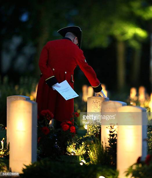 Chelsea Pensioner stands amongst the war graves during a militaryled vigil to commemorate the 100th anniversary of the beginning of the Battle of the...