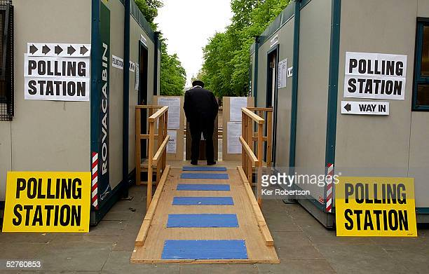 Chelsea Pensioner studies the list of candidates outside the portakabin polling station in Chelsea's Kings Road on May 5 2005 in London Voting in the...