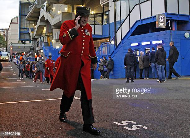 A Chelsea Pensioner talks on the phone as supporters gather outside the stadium ahead of the UEFA Champions League Group G football match between...