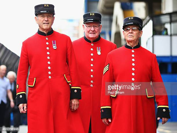 Chelsea Pensioners are seen outside the stadium prior to the Barclays Premier League match between Chelsea and Swansea City at Stamford Bridge on...