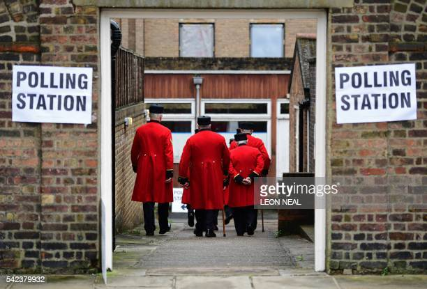 TOPSHOT Chelsea pensioners are ushered into a polling station to cast their ballot papers at the Royal Hospital in Chelsea west London on June 23 as...