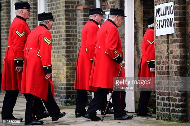 Chelsea pensioners are ushered into a polling station to cast their ballot papers at the Royal Hospital in Chelsea west London on June 23 as Britain...