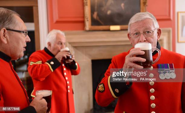 Chelsea Pensioners celebrate the birth of the Duke and Duchess of Cambridge's son at the Royal Chelsea Hospital in London by toasting and sending the...