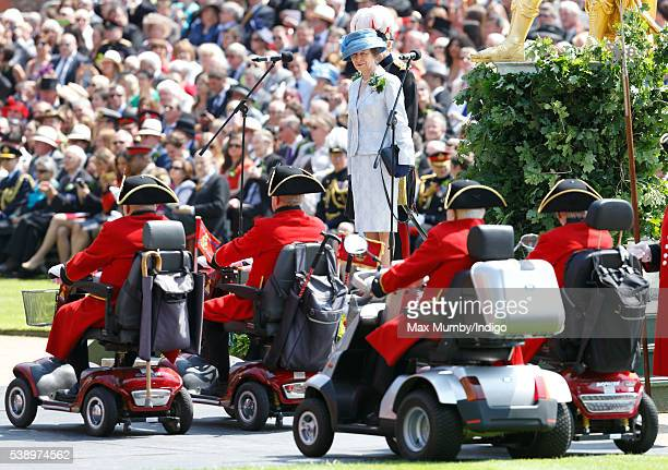 Chelsea Pensioners drive past Princess Anne The Princess Royal in their mobility scooters as she takes the salute during the annual Founder's Day...
