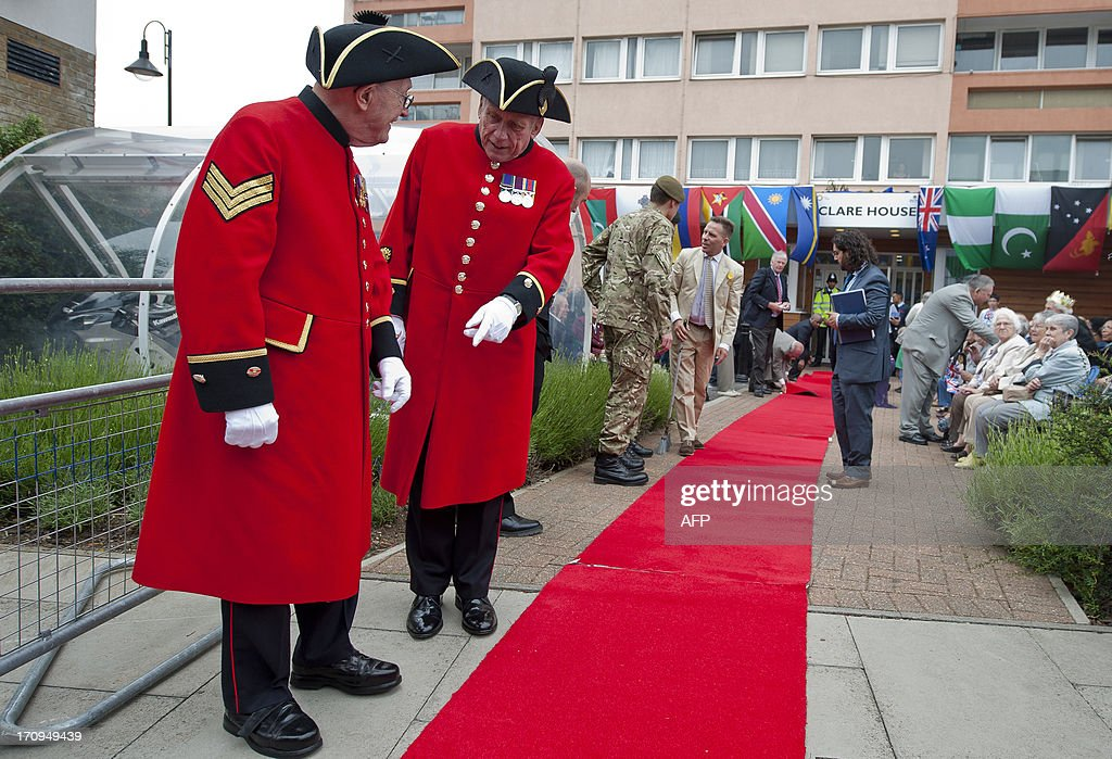 Chelsea pensioners inspect the red carpet as the residents prepare for the visit of Birgitte, Duchess of Gloucester to Old Ford, East London on June 20, 2013 during a Coronation Party organised by the residents to celebrate the 60th anniversary of the coronation of Queen Elizabeth II. AFP PHOTO / WILL OLIVER