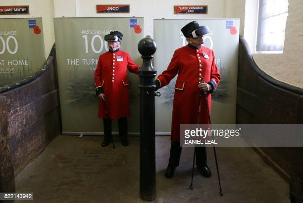 TOPSHOT Chelsea pensioners John Kidman and Bill 'Spud' Hunt wear Virtual Reality headsets at a photocall during the Royal British Legion launch of...