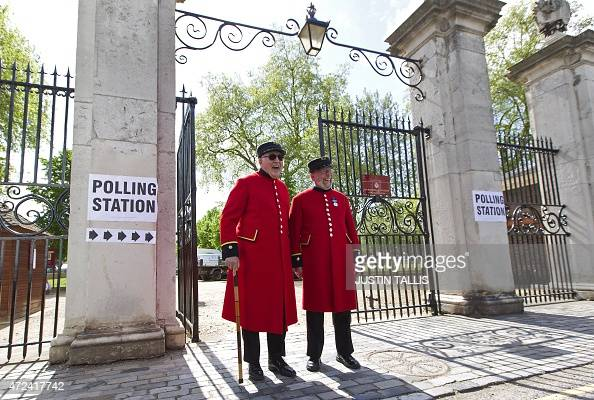 Chelsea pensioners leave a polling station after casting their votes in London on May 7 as Britain holds a general election Polls opened Thursday in...