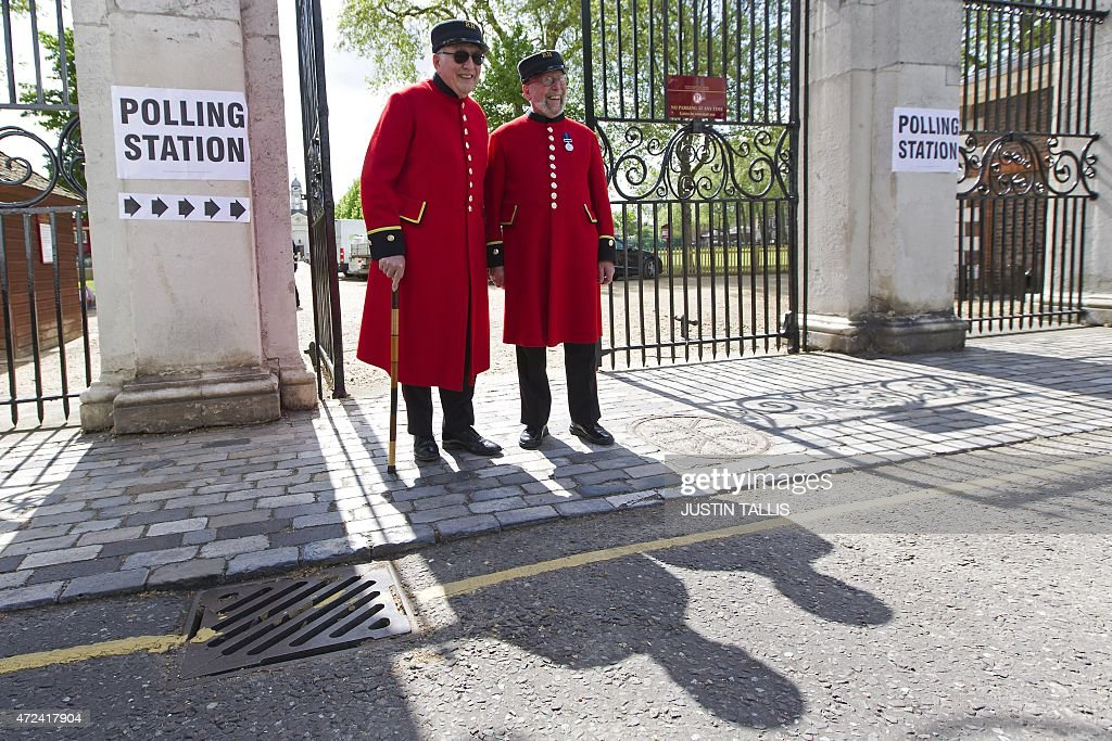 Chelsea pensioners leave a polling station after casting their votes in London on May 7, 2015, as Britain holds a general election. Polls opened Thursday in Britain's closest general election for decades with voters set to decide between the Conservatives of Prime Minister David Cameron, Ed Miliband's Labour and a host of smaller parties.