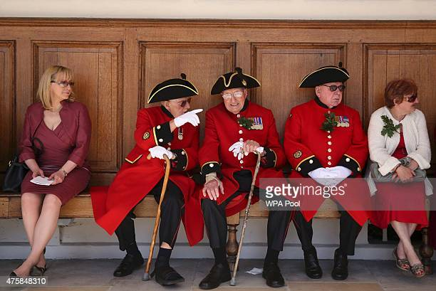 Chelsea Pensioners rest before the Founder's Day Parade at the Royal Hospital Chelsea on June 04 2015 in London United Kingdom