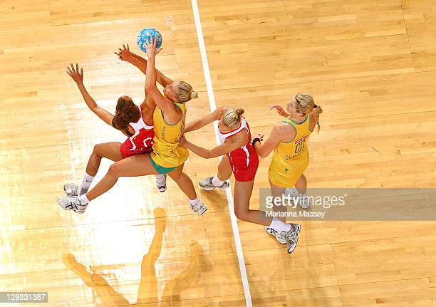 Chelsea Pitman of Australia against Serena Guthrie of England go for the ball as Julie Corletto of Australia looks on during game three of the...