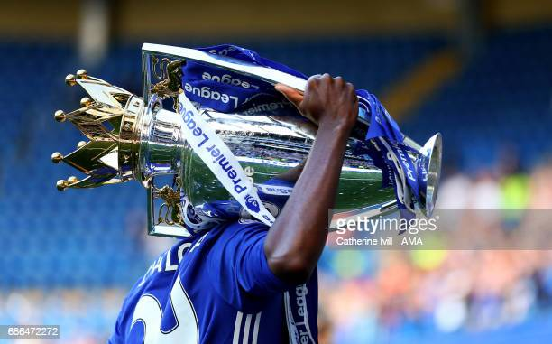 Chelsea player carries the Premier League Trophy during the Premier League match between Chelsea and Sunderland at Stamford Bridge on May 21 2017 in...
