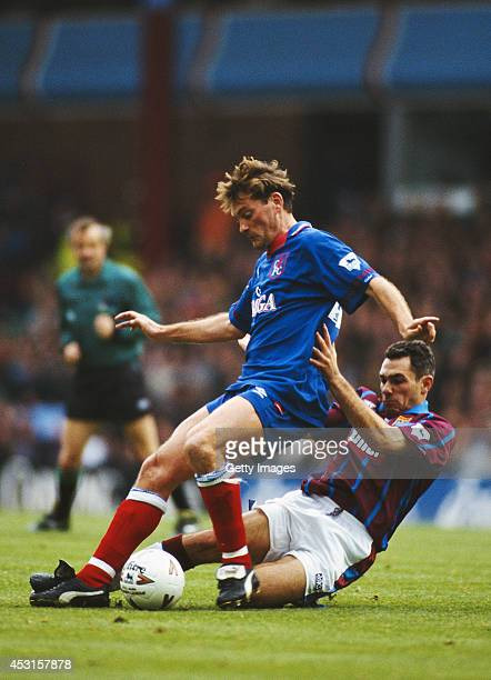 Chelsea player Glenn Hoddle is challenged by Guy Whittingham of Aston Villa during a Premiership match between Aston Villa and Chelsea at Villa Park...