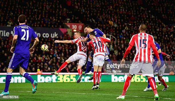 Chelsea player John Terry heads in the opening goal during the Barclays Premier League match between Stoke City and Chelsea at Britannia Stadium on...