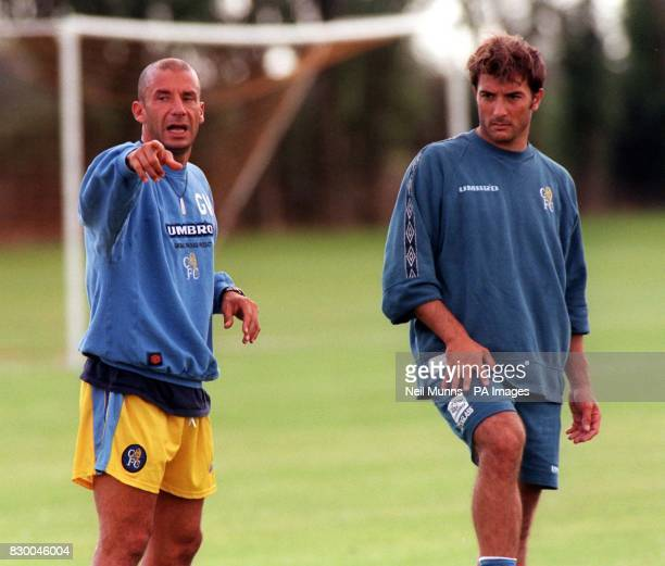 Chelsea player manager Gianluca Vialli points the way to new signing Pierlugi Casiraghi during a training session today Photo by Neil Munns/PA