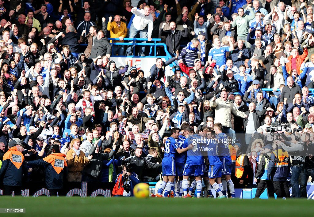 Chelsea players and fans celebrate as Frank Lampard scores their first goal during the Barclays Premier League match between Chelsea and Everton at...